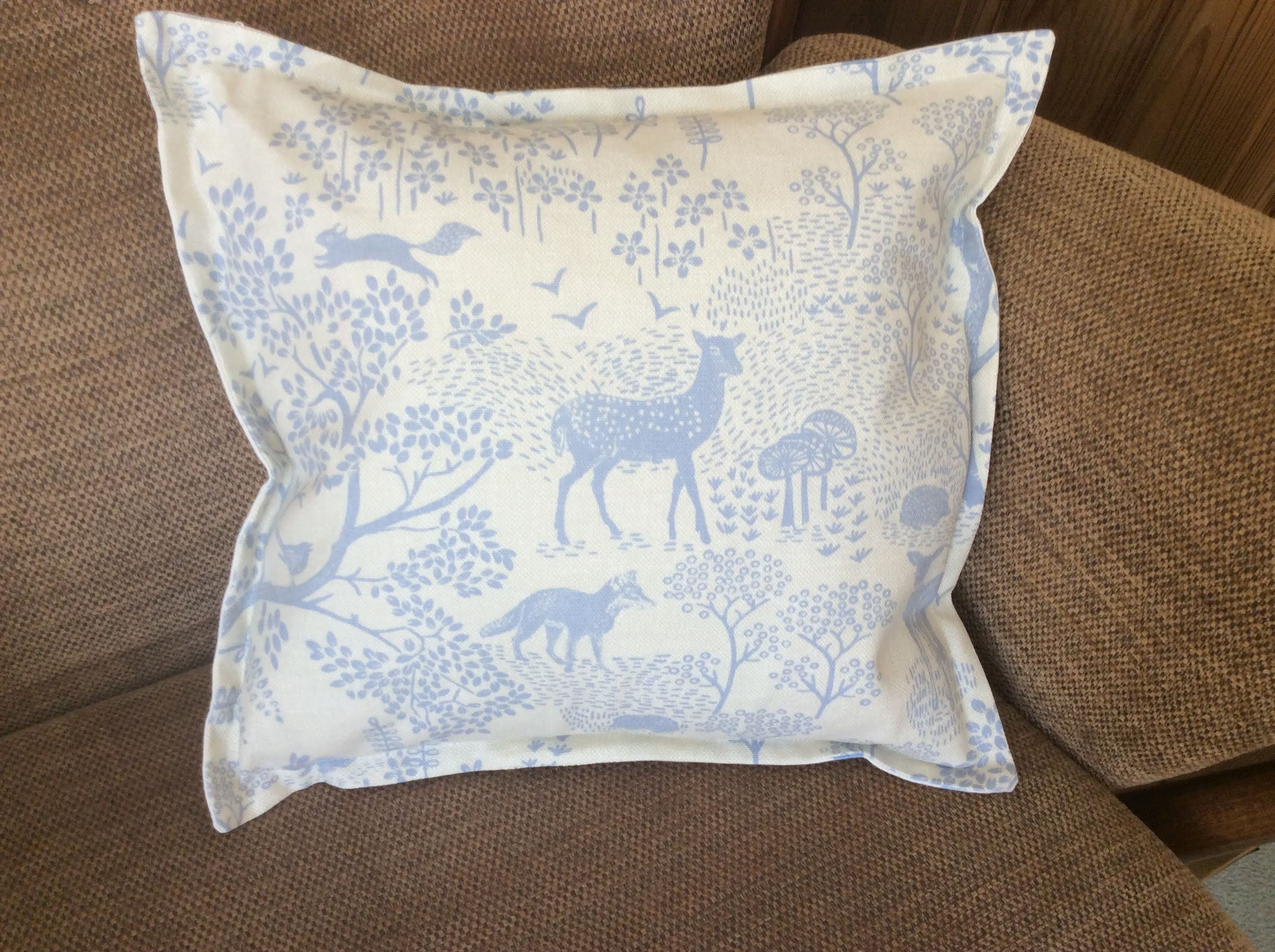 Cushion - pale blue woodland